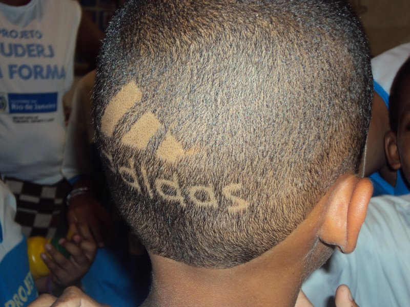 Adidas hits back at Nike by shaving logo into kids heads! (1/3)