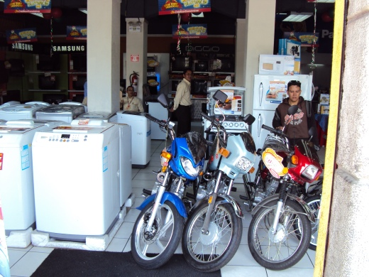 Washing Machines for sale next to Motorbikes?