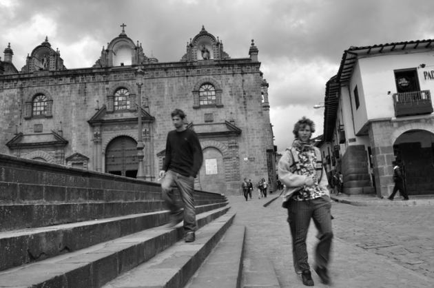 Cusco Catedral Walking and Smoking. Copyright Guy Grigsby 2010