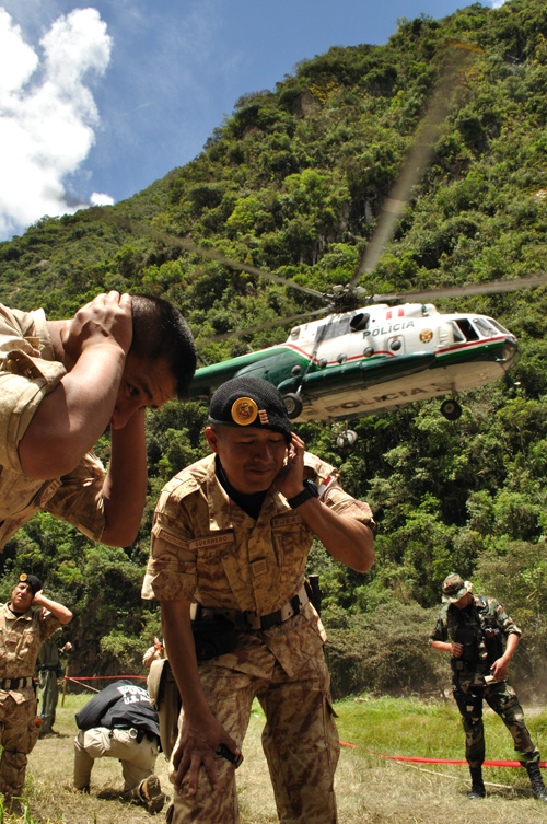 Departure: The evacuation of Aguas Calientes by the Peruvian Military 2010. Copright Guy Grigsby 2010