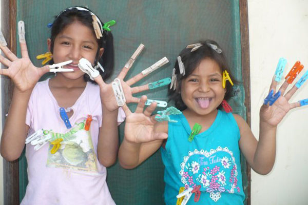 Peruvian Children with Pegs